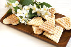 Waffles composition with flowers Royalty Free Stock Photos