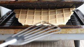 Preparation of wafers from fresh dough in a waffle maker in daylight. Waffles. Cooking fresh hot waffles in a waffle maker stock video footage