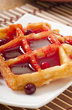 Waffles with cranberry syrup Royalty Free Stock Images