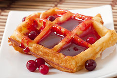 Waffles with cranberry syrup Stock Photography