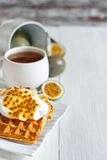 Waffles with cream and passionfruit background Royalty Free Stock Photos