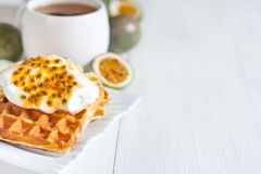 Waffles with cream and passionfruit background Stock Images