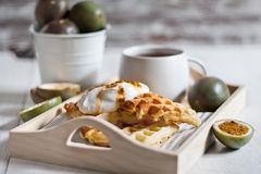 Waffles with cream and passionfruit Royalty Free Stock Image