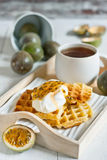 Waffles with cream and passionfruit Stock Photo