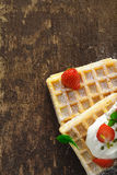 Waffles with cream and strawberries Royalty Free Stock Photos