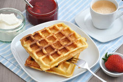 Waffles with cream and strawberries Royalty Free Stock Photography