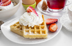 Waffles with cream and strawberries for breakfast Royalty Free Stock Photos