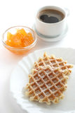 Waffles with a cup of coffee and jam Stock Photography