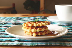 Waffles and a cup of coffee. Start the morning with waffles stock images