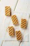 Waffles doces em um papel do cozimento Fotografia de Stock Royalty Free
