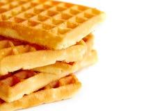 Waffles dourados no branco Imagem de Stock