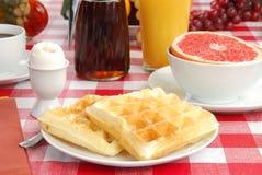 Waffles e um ovo fervido macio Imagens de Stock Royalty Free