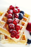 Waffles with fresh berries Stock Images