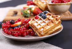 Waffles with fresh berries. Fresh berries and sweet waffles for breakfast Stock Photography