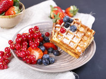 Waffles with fresh berries. Fresh berries and sweet waffles for breakfast Royalty Free Stock Photography