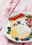 Waffles with fresh berries Stock Photo