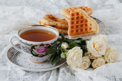 Waffles with fresh blueberries and flowers.Breakfast Royalty Free Stock Photography