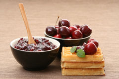Waffles and fresh cherry jam Royalty Free Stock Photography