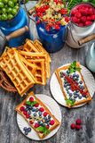 Waffles with fresh collected berry fruit Stock Images