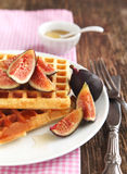 Waffles with fresh figs and honey Stock Images