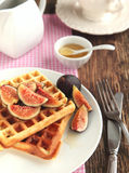 Waffles with fresh figs and honey Royalty Free Stock Photography