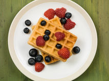 Waffles With Fresh Raspberries and Blueberries Royalty Free Stock Photography