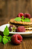 Waffles and fresh raspberries. On a wooden background Stock Photo