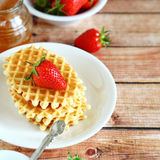 Waffles with fresh strawberries on a plate Stock Photo
