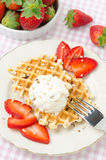 Waffles with fresh strawberries and whipped cream Stock Photo