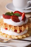 Waffles with fresh strawberry and cream close-up vertical Royalty Free Stock Photo