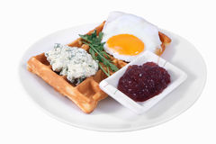 Waffles and fried egg on plate, isolated on white background. Royalty Free Stock Photo