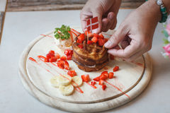 Waffles With Fruit and Maple Syrup. On a Marble Counter,in Thailand royalty free stock images