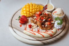 Waffles With Fruit and Maple Syrup. On a Marble Counter,in Thailand royalty free stock photography