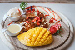 Waffles With Fruit and Maple Syrup. On a Marble Counter,in Thailand royalty free stock image