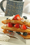 Waffles with fruit and whipped cream Stock Photography