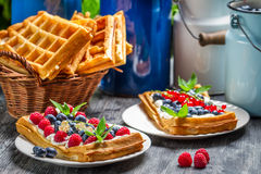 Waffles with fruit and whipped cream Stock Photos