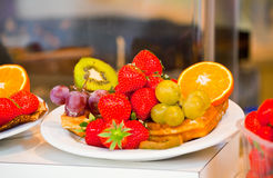 Waffles with fruits and berries on a plate Royalty Free Stock Photo