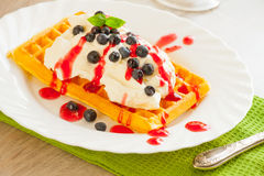 Waffles with fruits and whipped cream Royalty Free Stock Photos