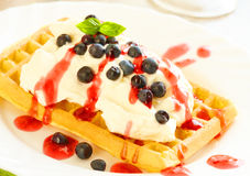 Waffles with fruits and whipped cream stock photos