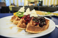 Waffles. With fruits and whipped cream Stock Photography