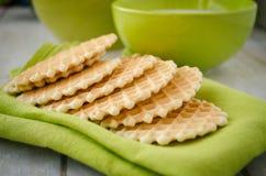Waffles on a green table napkin closeup. Waffle dessert on a green table napkin closeup. Green ceramic crockery on a background Royalty Free Stock Photography