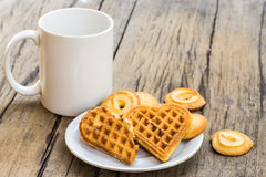Waffles heart shaped and cookie on white plate and coffee cup Royalty Free Stock Photo
