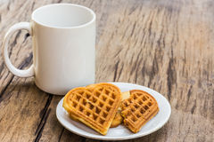 Waffles heart shaped on white plate and coffee cup Royalty Free Stock Photography