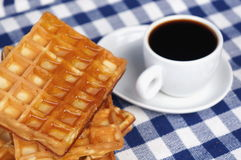 Waffles with honey. And a cup of coffee Royalty Free Stock Photography