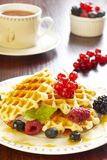 Waffles with honey and berries Stock Photo