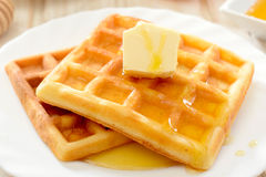 Waffles with honey and butter Royalty Free Stock Image