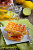 Waffles with honey and lemon Royalty Free Stock Photo