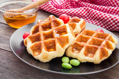 Waffles with honey on plate Stock Photography