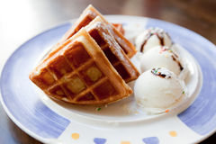 Waffles and ice cream. Dessert on a plate Royalty Free Stock Photos