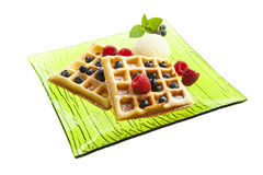 Waffles with ice cream, blueberries and raspberries Royalty Free Stock Photography